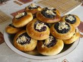 The kitchen table was loaded with kolaches. I knew that food would continue to roll in.